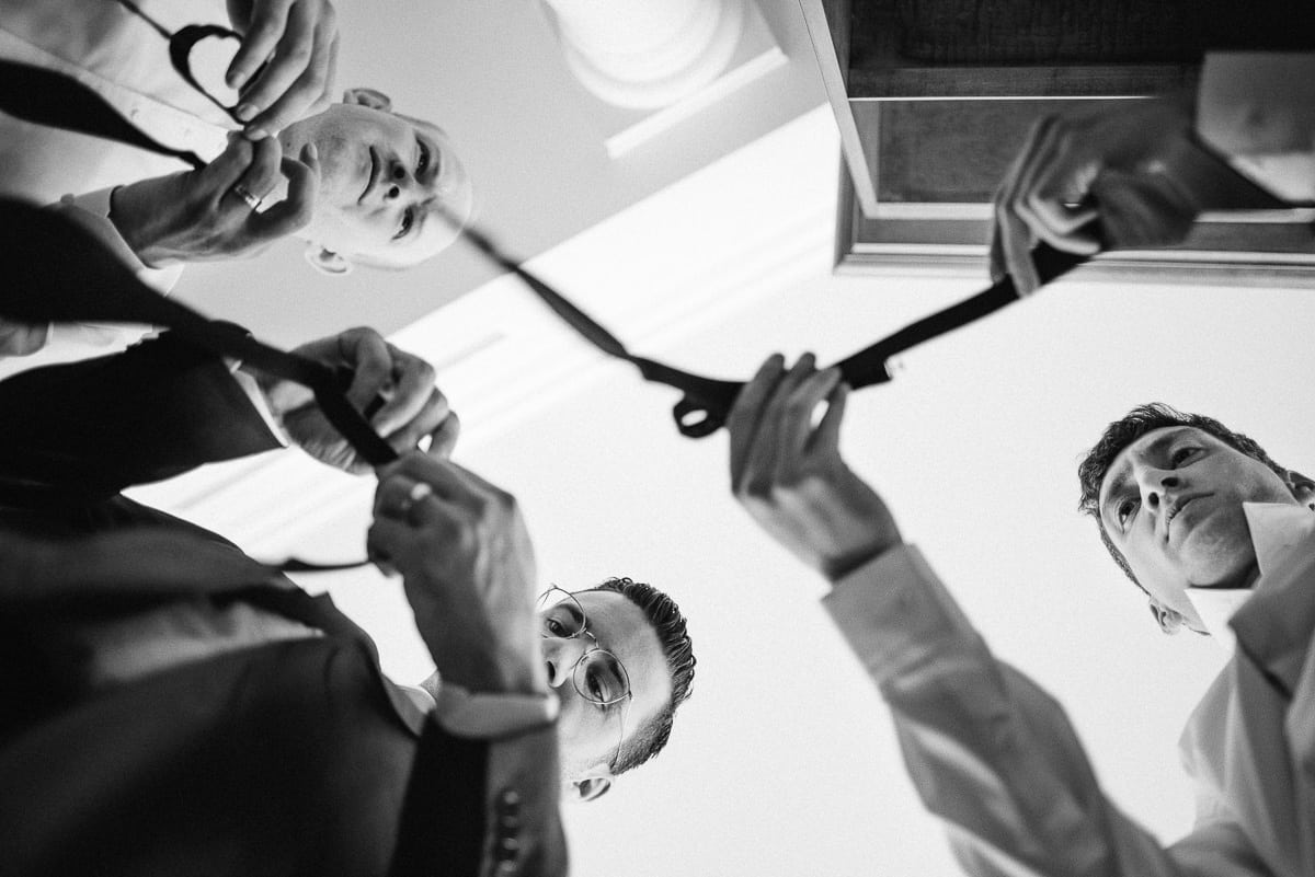 Groomsmen tying bowties